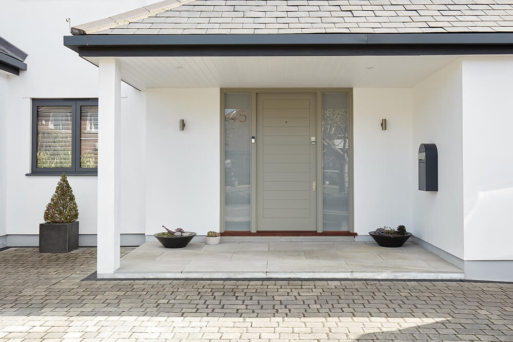 Contemporary grey front door with sidelights